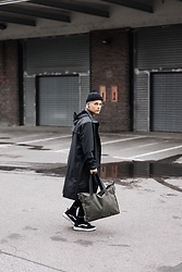 Kevin Elezaj - Vans Sneakers, Rains Raincoat, Topman Beanie, Eastpak Bag - Rainy