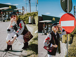Andreea Birsan - Baker Boy Cap, Striped Embroidered Top, White Button Down Shirt, Leather Vest, Ruby Red Lace Metropolis Bag, Black Ankle Sock Boots, White Straight Mom Jeans, Red Tinted Retro Sunglasses - The baker boy cap