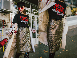 Andreea Birsan - Midi Slit Sequin Skirt, Knotted Black Graphic T Shirt, Beige Trench Coat, Retro Red Tinted Sunglasses, Black Baker Boy Cap, Ruby Red Lace Metropolis Shoulder Bag, Patent Over The Knee Boots - How to style a sequin skirt