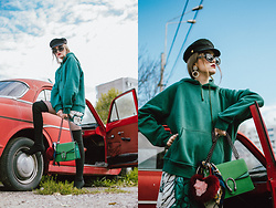 Andreea Birsan - Emerald Hoodie, Floral Printed Mini Dress, Rhinestone Fishnet Tights, Over The Knee Heeled Sock Boots In Black, Green Suede Shoulder Bag, Heart Fur Charm, Silk Scarf, 90s Square Rhinestone Sunglasse, Statement Earrings - Hoodie and baker boy cap