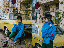 Andreea Birsan - Blue Cashmere Turtleneck Sweater, Green High Waisted Trousers, Floral Socks, Black Patent Ankle Boots, Prada Borsa A Mano Saffiano Lux Cobalt Bag, Baker Boy Cap, Gold Hoop Earrings - Sweather & trousers