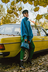 Andreea Birsan - Blue Cashmere Sweater, Baker Boy Cap, Gold Hoop Earrings, Cobalt Saffiano Lux Borsa A Mano, Green High Waist Trousers, Socks, Black Pantent Heeled Boots - Not a love story