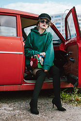 Andreea Birsan - Green Hoodie, Dress, Green Suede Bag, Scarf, Fur Charm, Rhinestone Earrings, Square Rhinestone 90s Sunglasses, Black Baker Boy Cap, Black Heeled Sock Boots, Rhinestone Fishnet Tights - Hoodie kind of day