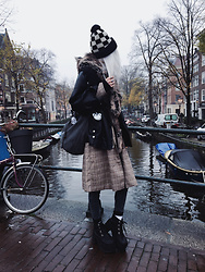 Kimi Peri - Vii & Co. Plaid Coat, Vii & Co. Vegan Leather Jacket, T.U.K. Footwear Distressed Ankle Nosebleed Boots, Monki Jeans, Amazon Spirithood, Na Kd Bucket Bag, Underground The Brook Checkboard Beanie - Amsterdam Magic