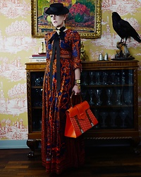 The wardrobe of Ms. B - Valentino Dress, Goyard Orange Bag, Hermes Black And Gold Bracelet - Mary Poppins on Safari