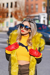 Eliza Romero - Quay On The Prowl Sunnies, River Island Yellow Faux Fur Hoodie Parka, River Island Red Leather Gloves, Puma Fenty X Yellow Turtleneck, Asos Skinny Military Khaki Pants - Yellow With A Pop Of Red