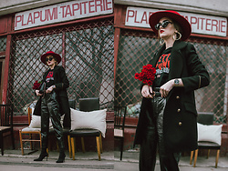 Andreea Birsan - Red Fedora Hat, Gold Hoop Earrings, Punk T Shirt, Watch, Gucci Belt, Double Breasted Military Coat With Golden Buttons, High Waisted Patent Trousers, Black Heeled Sock Boots, Striped Bag With Eyelet Details, Black Cat Eye Sunglasses - The lady with the red hat
