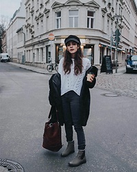 Frankie Miles - Stradivarius Cap, Patrizia Pepe White Knitwear, Lee Black Skinny Jeans, Monki Black Coat, Jost Leather Bucket Bag, Bench Winterboots - Berlin Winter