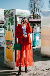 Andreea Birsan - Gold Hoop Earrings, Red Faux Fur Coat, Retro Sunglasses, Gucci Logo T Shirt, Red Tulle Skirt, Socks, Black Heeled Sock Boots, Green Suede Shoulder Bag - Red alert