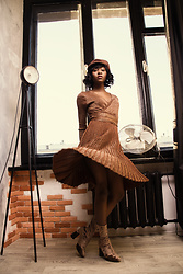Melody Jacob -  - Would you wear an all brown outfit? Dress by Metisu