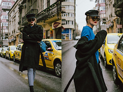 Andreea Birsan - Black Teddy Bear Coat, Black Newsboy Cap, Cat Eye Sunglasses, Earrings, Blue Cashmere Sweater, High Waisted Gingham Trousers, Prada Blue Mini Bag, Heeled Black Sock Boots - Teddy Bear Coat