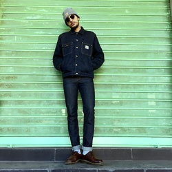 Mohamed Samaras - Carhartt Beanie, Ray Ban Club Master, Carhartt Jacket, A.P.C. Jeans, Dr. Martens Shoes - What doesn't kill you fucks you up mentally