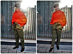 Reni E. -  - Utility pants and red turtle neck