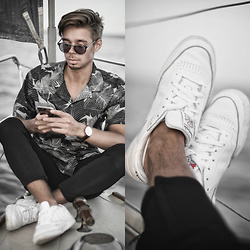 Edgar - Midnight Surf Monochrome Floral Shirt, Zara Black Cropped Pants, Reebok White Classics Sneakers, Daniel Wellington Leather Watch, Black Framed Optical Sunglasses - HOLIDAYS ON THE BEACH