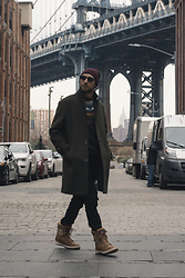 Hector Diaz - Topman Olive Green Topcoat (Similar), Original From Iceland Fair Isle Knit Wool Sweater (Similar), Club Monaco Black Corduroy Pants, Original From Iceland Fair Isle Knit Hat (Similar), Pajar Winter Boots, Ollie Quinn Shades - NYFW FW18: Day 1 (Dumbo)