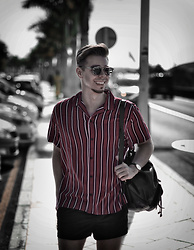 Edgar - Asos Red Striped Shirt, Asos Black Swim Shorts, Asos Black Leather Backpack, Daniel Wellington Black Leather Watch, Black Framed Optical Glasses - CANARY ISLANDS