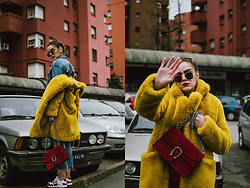 Andreea Birsan - Yellow Faux Fur Coat, Red Suede Shoulder Bag, Gucci White And Red Leather Sneakers, Cropped Star Printed Denim Jacket, Cropped Raw Hem Jeans, Heaxagonal Sunglasses, Heart Shapped Earrings - Yellow faux fur coat