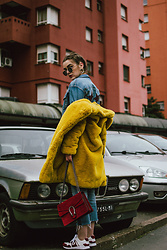 Andreea Birsan - Raw Hem Cropped Denim Jacket, Yellow Faux Fur Coat, Hexagonal Sunglasses, Heart Shaped Earrings, Red Suede Shoulder Bag, Cropped Raw Hem Levi's Jeans, Gucci White And Red Leather Sneakers - Double denim