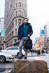 Hector Diaz - Andrew Marc Faux Fur Down Parka, Topman Teal Turtleneck Sweater, Topman Checkered Print Black And White Slacks, Ted Baker Backpack, Sperry Topsider Waterproof Chukka Boots, Ollie Quinn Shades - NYFW FW18: Day 3 (FlatIron)