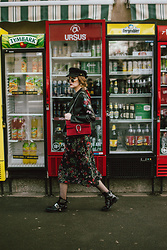 Andreea Birsan - Baker Boy Hat, Floral Embroidered Leather Jacket, Red Suede Shoulder Bag, Midi Floral Dress, Oval Sunglasses, Biker Boots, Fishnet Tights With Rhinestones - Florals