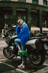 Andreea Birsan - Blue Faux Fur Jacket, Gold Hoop Earrings, Small Cat Eye Sunglasses, Denim Jacket, Blue Cashmere Turtleneck Sweater, Cropped Jeans, White And Red Leather Sneakers, Green Saffiano Leather Shoulder Bag With Studs And Stones - Blue faux fur jacket