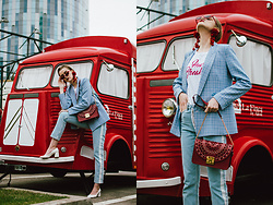 Andreea Birsan - Baby Blue Checked Blazer, Printed T Shirt, Red Micro Sunglasses, Red Statement Earrings, Statement Side Panel Jeans, White Heels, Ruby Red Metropolis Bag - Statement jeans