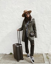 Tiffany Wang - Lack Of Color Hat, Stutterheim Raincoat, Agolde Jeans, Vans Sneakers, Away Luggage - TRAVEL AWAY