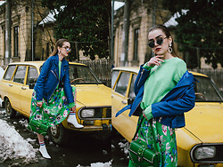 Andreea Birsan - Green Sweater, Mirrored Sunglasses, Rhinestone Earrings, Green Midi Floral Dress, White Leather Ankle Boots, Cobalt Blue Genuine Leather Biker Jacket, Green Bag With Studs And Stones - Green and cobalt blue