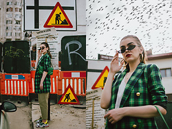 Andreea Birsan - Small Cat Eye Sunglasses, Gold Hoop Earrings, Check Printed Blazer, Green Shoulder Bag, Khaki Trousers, Chunky Trainers, White Tank Top - Spring checks