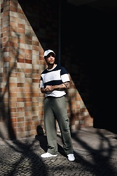 Kevin Elezaj - Common Projects Sneakers, Acne Studios Pants, Farah T Shirt, Obey Cap - Shadow games