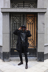 Jon The Gold - Diesel Brown Leather, H&M Leather Jacket, Strellson Black Camo Raincoat, Lacoste Black Sunglasses - Another Black Monday