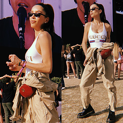 Claudia Salinas - Gucci Swimsuit, Andy Wolf Sunglasses, Gucci Belt Bag, Army Surplus Flight Suit, Dr. Martens Jadon Boots - Coachella Day 3