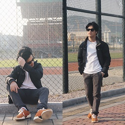 Seff Musa - Saint Laurent Black Shades, Zara White Silk Sweatshirt, Pull & Bear Black Parka, Zara Grey Checkered Trousers, Zara Orange Sneakers - Up in arms