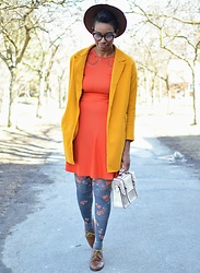 Sushanna M. - Thrifted Brown Hat, Yellow Wool Coat, Orange Dress, Blue Floral Tights, Cream Scalloped Satchel, Brown Wingtip Oxfords - Bright Idea