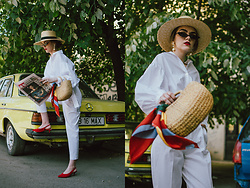 Andreea Birsan - Balloon Sleeve White Shirt, White Peg Trousers, Red Suede Slingback Shoes, Woven Bag, Scarf, Small Cat Eye Sunglasses, Straw Boater Hat, Earrings - How to wear your white shirt in spring