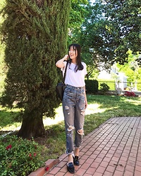 See Yang - H&M White Oversized Tee, Express Super High Waisted Distressed Jeans, Kmart Black Mule Loafers - Basic at its best