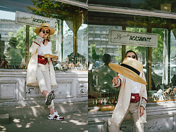 Andreea Birsan - Straw Boater Hat, Beige Linen Trousers, White Tank Top, Linen Jacket, Scarf, White Leather Sneakers, Red Fanny Bag, Oval Sunglasses - The linen look