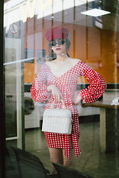 Andreea Birsan - Gingham Dress, White Basket Bag, Red Baker Boy Hat, Small Cat Eye Sunglasses, Gold Hoop Earrings - The gingham dress