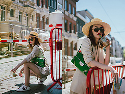 Andreea Birsan - Beige Linen Blazer, Green Shoulder Bag With Studs And Stones, Straw Boater Hat, Oversize Sunglasses, White Sneakers With Hearts, Khaki Shorts - The shorts you won't stop wearing