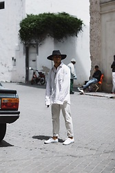 Kevin Elezaj - Vans Sneakers, A.P.C. Trousers, Gap Shirt, Brixton Hat - All white