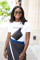 Iféoluwa Anani - Thrive Société Skirt, Berskha Fanny Pack, H&M No Planet B T Shirt - Athleisure Chic
