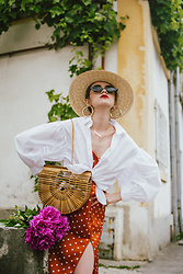 Andreea Birsan - Straw Boater Hat, Gold Hoop Earrings, Gold Necklaces, Small Cat Eye Sunglasses, White Balloon Sleeve Shirt, Ark Bamboo Bag, Polka Dot Slip Dress - Dreaming of Cuba