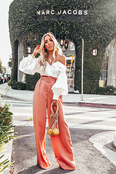 Maria De La Cruz - Haute & Rebellious Off Shoulder Blouse With Puff Sleeve, Haute & Rebellious Palazzo Pant With Belt, Haute & Rebellious Small Straw Mesh Bag, Haute & Rebellious Flat Plated Hoop Earrings - Statement Top with Belted Palazzo Pant