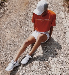 Drew Harrison - Nike Orange Striped T Shirt, Levi's® White Denim Shorts, Nike White Sneakers, Adidas White Hat - Between a rock and a hard place.