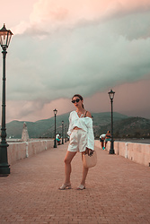 Theoni Argyropoulou - Blouse, H&M Silk Shorts, Zaful Straw Bag, Suede Mules, Cat Eye Sunglasses - Creamy Hues on somethingvogue.com