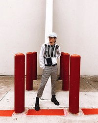 "Dustin Faires - Dr. Martens Black Boots, Forever 21 Checkered Dress Pant, Asos Crossbody Side Bag, Goodie Brand ""Goodie"" Sweatshirt, Firmoo Glasses, Gray Camper Cap - G O O D I E"