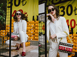 Andreea Birsan - Pinstripe Blazer, Pinstripe Trousers, Red Marmong Gg Pumps, Shoulder Bag, White T Shirt, Cat Eye Sunglasses, Chain Belt - The pinstripe suit