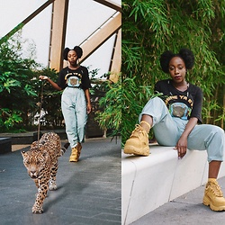 Enny Odeniyi - Pop Caven 'Shine Ya Eyes' Shirt, Buffalo London Sneakers, Mango Dad Pants - Welcome to the Jungle 2