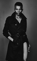 NIIMA BOA -  - Dressed in a black trenchant, ready to spy on him. Like...