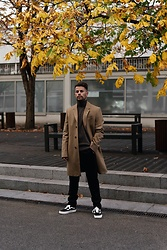Kevin Elezaj - Vans Sneakers, Libertine Pants, United Colors Of Benetton Turtleneck, Tiger Of Sweden Coat - Brown tones